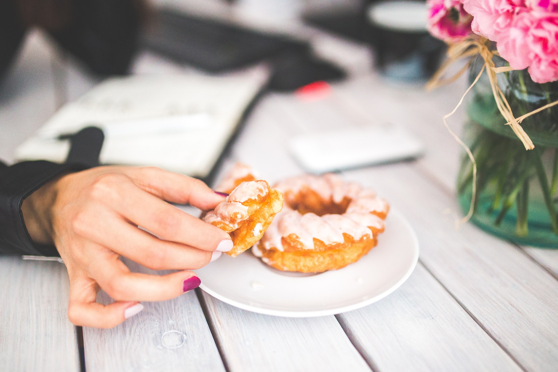 hand with a donut