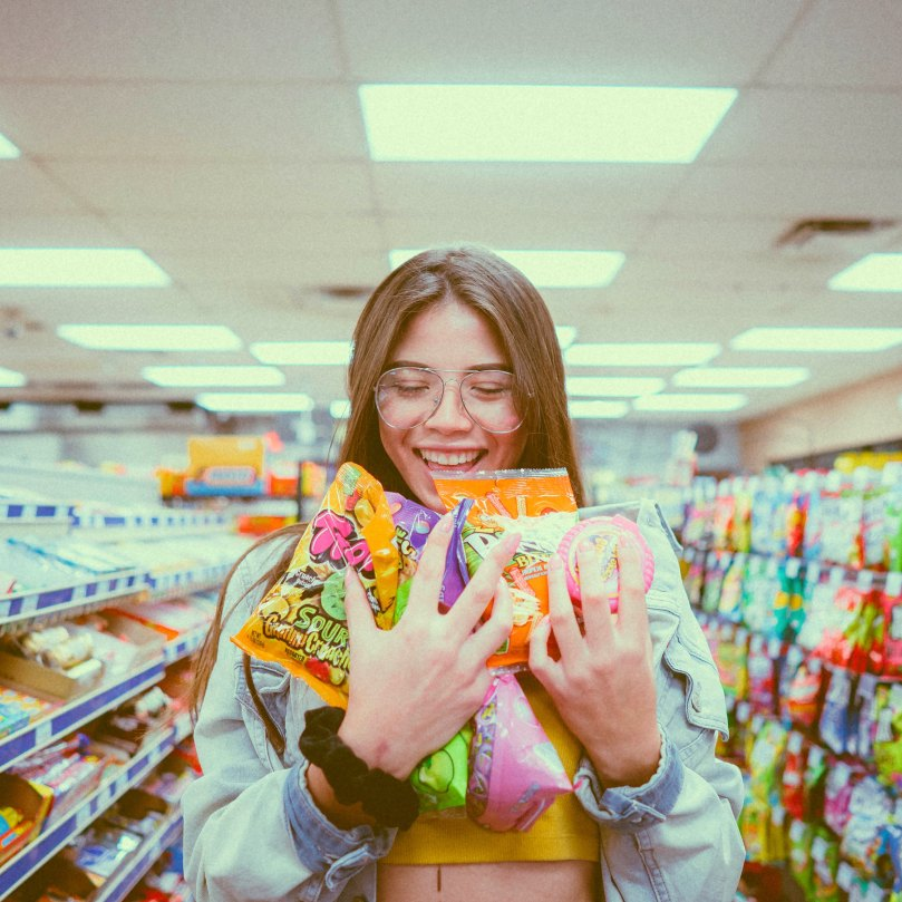 girl holding candy