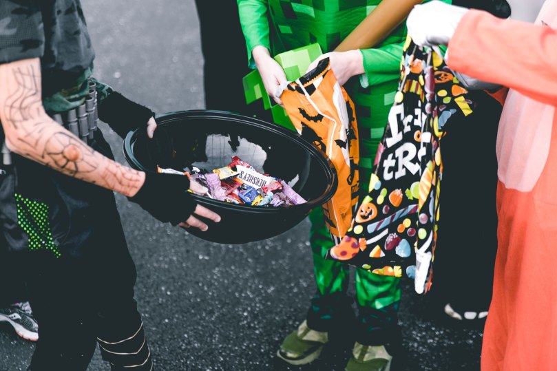 trick or treaters with a bowl of candy